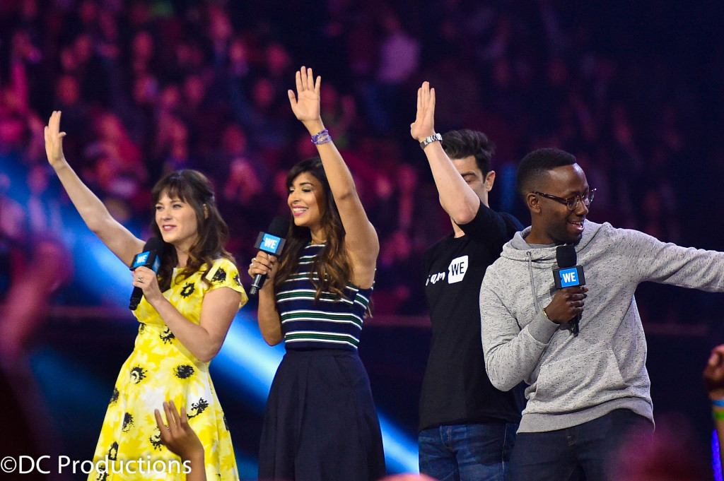 """INGLEWOOD, CA - APRIL 07: (L-R) Actors Zooey Deschanel, Hannah Simone, Max Greenfield, and Lamorne Morris speak onstage at WE Day California 2016 at The Forum on April 7, 2016 in Inglewood, California."