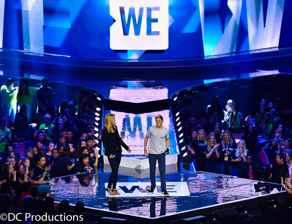 """INGLEWOOD, CA - APRIL 07: WE Day California Co-Chair Stephanie Argyros (L) and Gunnar Argyros speak onstage at WE Day California 2016 at The Forum on April 7, 2016 in Inglewood, California. (Photo by Mike Windle/Getty Images for WE Day)"""