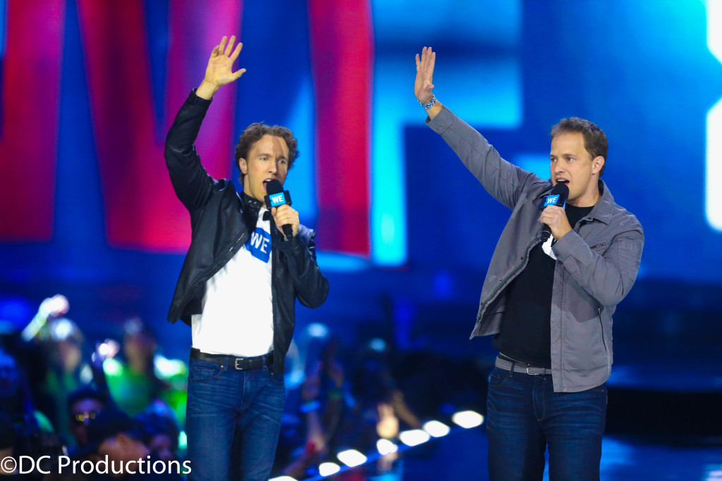 """INGLEWOOD, CA - APRIL 07: Co-Founder of WE Day, Free The Children and ME to WE Craig Kielburger (L) and Chairman/CEO at the Allstate Corporation Tom Wilson onstage at WE Day California 2016 at The Forum on April 7, 2016 in Inglewood, California. (Photo by Frederick M. Brown/Getty Images for WE Day )"""