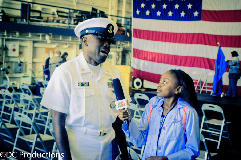 Thandi Chirwa interviews Navy Personnel during the U.S Navy Immigration naturalization ceremony media ceoverage