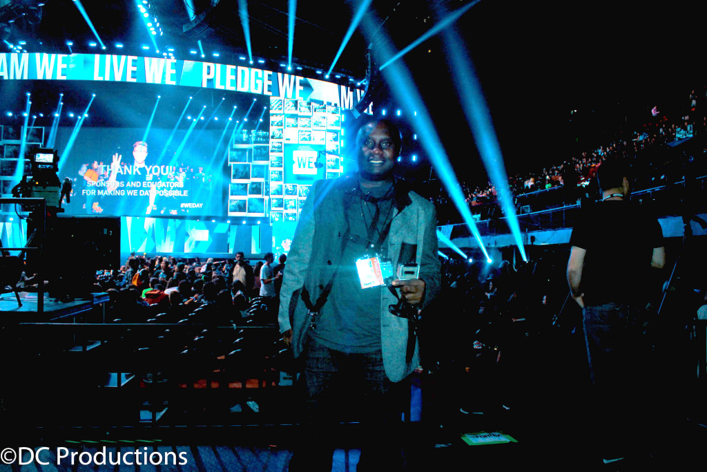 """INGLEWOOD, CA - APRIL 07: Channel A TV Founder Davies Chirwa while filming a segment at WE Day California 2016 at The Forum on April 7, 2016 in Inglewood, California."