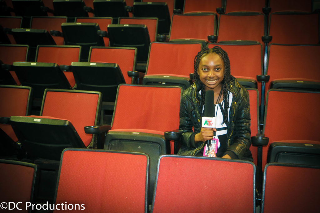 Thandi Chirwa doing drops for Channel A TV at We Day Seattle.