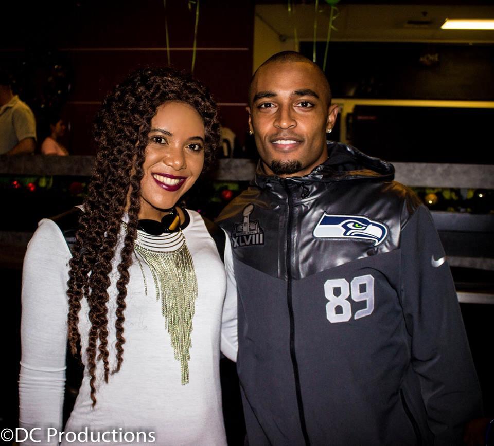 Grace Maseko with Seahawks Doug Baldwin